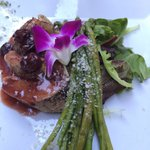 Pork tenderloin with luscious cheeses, Grand Marnier cherry sauce, exquisite vegetables ,an edib