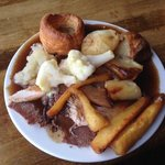 huge plate of roast beef and turkey