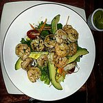 Freshness of Bahia: Pinki delicious shrimp sautéed in white wine on a bed of salad with avocado,