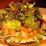 LAYERED SEAFOOD COCKTAIL; Shrimp, lobster, avocado, and orange chili sauce.