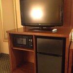 Living room entertainment center + fridge + microwave