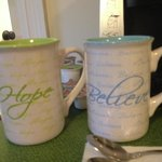 Cute coffee cups along with a keurig in our room.