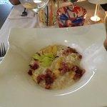 Risotto mantecato con pesche e pancetta