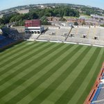 A fisheye view of Croke Park Field from the skywalk with Dublin in the background.