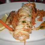 Skewer of huge  Tiger Prawns  on oriental rice with chili sauce ..heavenly