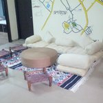 common room with traditional seating and tyre coffee table