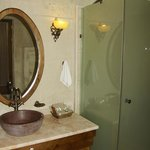 Huge shower and beautiful vessel sink
