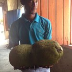 Our tour guide holding a Jackfruit