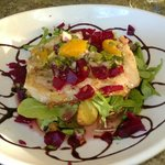 Fresh halibut served with greens, beets and mango