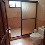 Very spacious shower, and sink area is outside the bathroom.  Very nice.