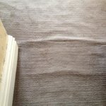 shabby old badly fitted carpet