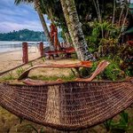 Hammock and benches fronting the beach.