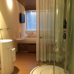 View from the entrance to shower and bed