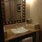 Bathroom furnished with marble and wood