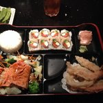 Combo plate with salmon and Philadelphia roll.