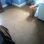 Water damage on the rug in our room