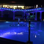 main building & pool at night