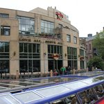 View of the Hard Rock cafe from across the canal showing the outdoor seating available.