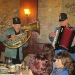 A tuba and an accordion player perform every night.