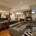"""Great Room with seating for 40 + Full Bar and dinner seating for 20, 70"""" LCD TV and Fireplace"""
