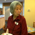 "Janice, who is a server in the coffee shop.  Here she is saying ""I love making people happy!"""