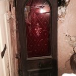 The original doors of the home were made of cranberry glass.