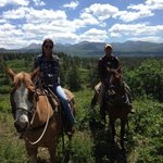 Horseback riding above the ranch and lake
