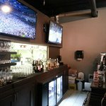 Bar with extensive drinks and tvs playing games