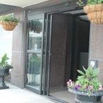 Front entrance has doorman