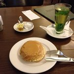 A dessert of a caramel filled pastry, and a mint tea.