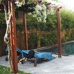 Lazy setup by the spa villa pool.