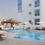Swimming pool with sunken pool bar