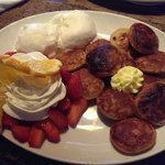 small pancakes with vanilla ice cream, whipped cream, fresh strawberries