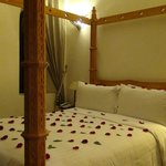 Four poster ceder wood bed.