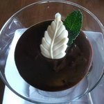 Chocolate pudding with a white chocolate leaf & fresh mint