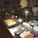 Breakfast - cold cuts, cheeses, hot food (meat and potatoes)on the right