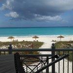 Hammock on the balcony, overlooking beach and water