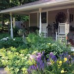 Front porch, with rocking chairs and garden.