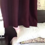 who designed this curtain hanging onto the pillow?!