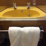 Misaligned taps in bedroom's sink area