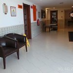 A hallway very well kept hotel..
