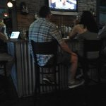 just a few folks enjoying  the bar at Barrel 135