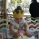 Enjoying the complimentary crown and coloring book