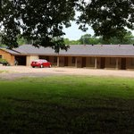 PHONE: 903-742-9291   BACK OF MOTEL WITH LARGE PARKING AREA AND NICE GARDEN AND SCENERY