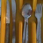 Stained, tarnished, old cutlery. Wouldn't call this 'A' class!
