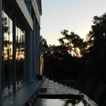 The setting sun reflecting against the glass protecting the outdoor dining area.
