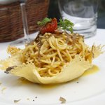 Spaghetti with fresh black truffle shavings in parmesan basket