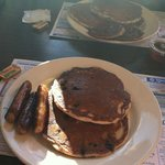 Blueberry pancakes, sausage and REAL maple syrup