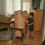 Grandson playing with log cabin house that was in our room.