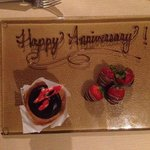 """Happy Anniversary"" chocolate-covered strawberries & cake"